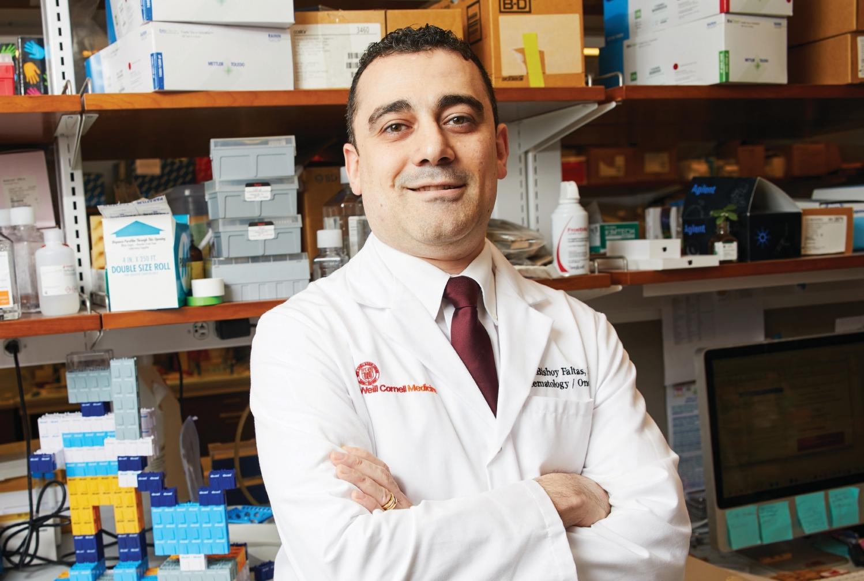 a man posing in a lab